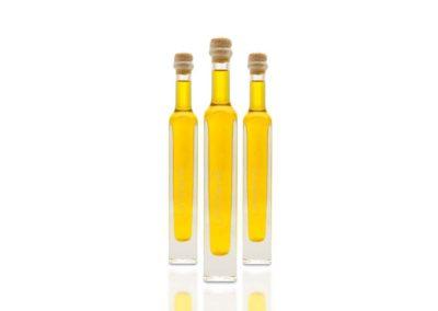 Professionelle Produktfotografie von Limonenöl in Flaschen